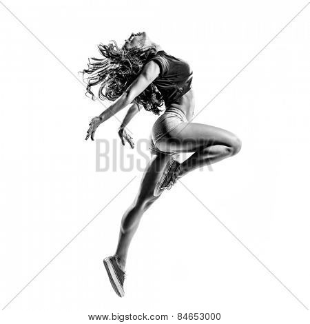 beautiful dancer jumping on a white isolated background in black and white color. high contrast black and white image
