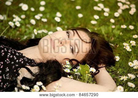 Girl Lying On A Meadow