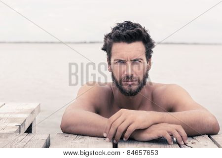 Confident Gorgeous Handsome Man With No Shirt At The Sea