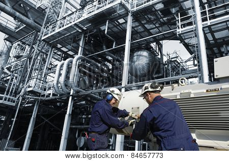 oil and gas workers inside refinery, main pump station