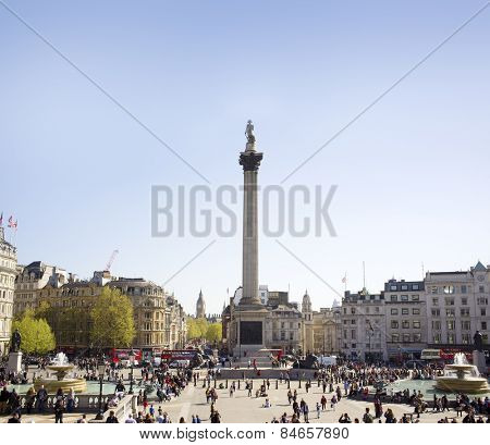 LONDON, UK - APRIL 16, 2014: Trafalgar Square is a public space and tourist attraction in central London, built around the area formerly known as Charing Cross.