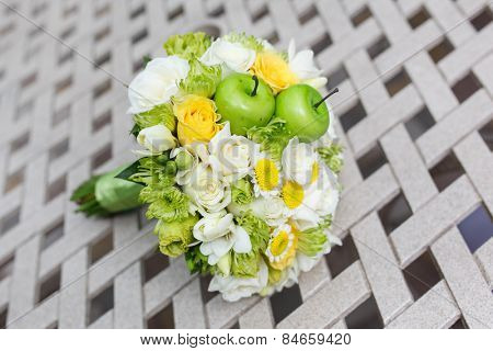 wedding bouquet of roses, chrysanthemum and freesia flowers