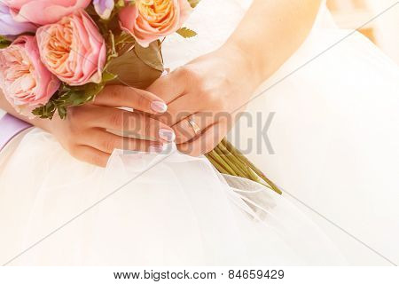 Beautiful wedding bouquet of paeonies in hands of the bride, french manicure