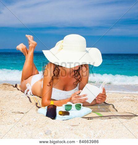 Beautiful woman on Sarakiniko beach. Just 8km outside the village Parga after Agia village in Syvota area, Greece.