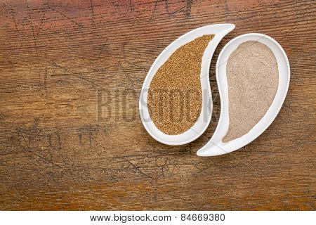 gluten free teff grain and flour in teardrop shaped bowls against grunge wood