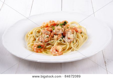 Scampi With Butter White Wine Sauce And Spaghetti