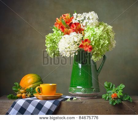 Still life with flowers and a yellow cup