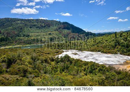 Panorama of Orakei Korako geothermal park, forest and Waikato river