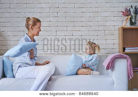 Babysitter playing with cute child