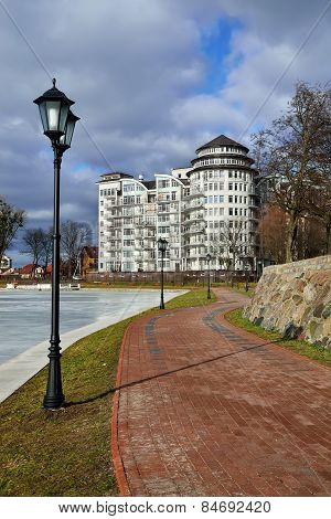 """Beautiful embankment of the lake """"Verhnee"""" is a favourite place of rest of the townspeople. Kaliningrad (until 1946 Koenigsberg) Russia poster"""
