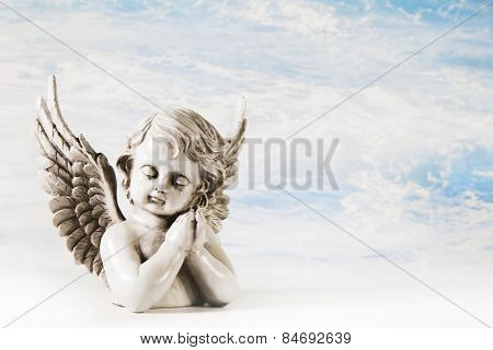 Sad angel on a background for a greeting card.
