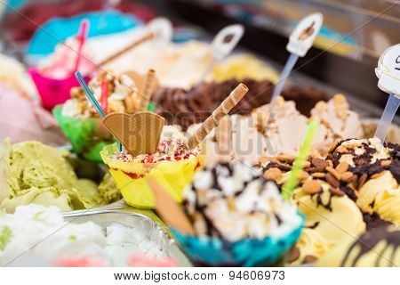 Many different sorts of ice in an ice cream parlor for sundaes and cones