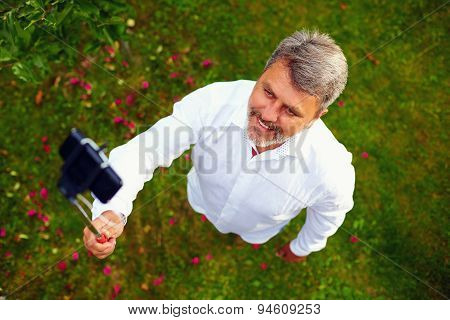 Happy Mature Man Taking Selfie On Phone