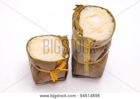 Vietnamese Cylindrical Sticky Rice Cake or Banh Tet on a white background