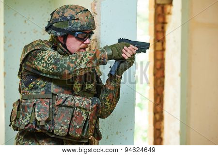 military. soldier with pistol in nato germany uniform indoors
