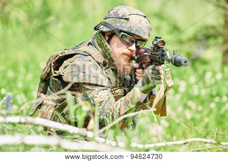 military. soldier targeting  with assault rifle at position in nato germany uniform outdoors