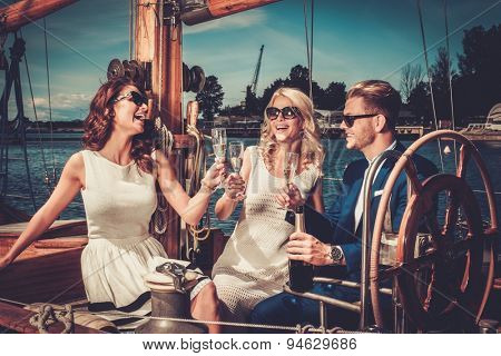 Stylish wealthy friends having fun on a luxury yacht  poster