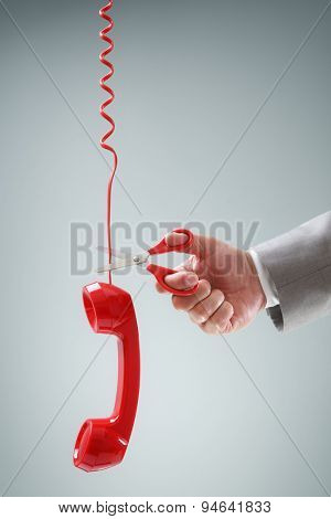 Scissors cutting telephone connection concept for wireless or freedom from phone contract