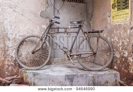 VARANASI, INDIA - 25 FEBRUARY 2015: Traditional Indian bicycle parked in corner of street. Bicycles are very common means of transportation on India's streets.