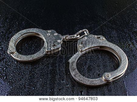 Police Handcuffs In The Drops Of Rain