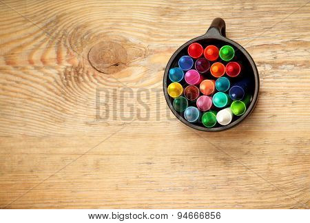 Crayons In A Mug On A Wooden Table