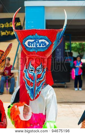 LOEI PROVINCETHAILAND- JUNE 27:Unidentified men wear ghost costumes at Ghost Festival (Phi Ta Khon - is masked procession celebrated by Buddhist) at Dan Sai district in Loei Province on June 27 2015.