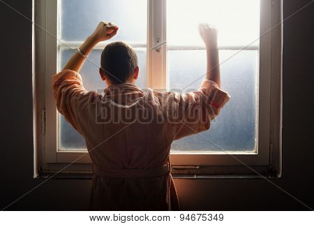 Female Cancer Patient Leaning On The Hospital Window