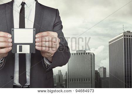 Businessman holding diskette in hands