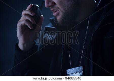 Police Officer Talking On Radio