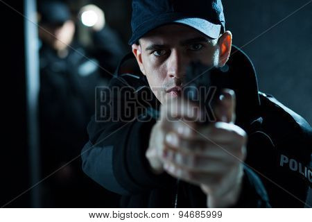 Armed Male Pointing Pistol