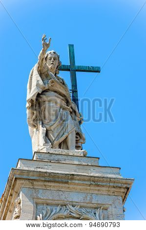 Statue At The Top Of Basilica Of Saint John Lateran In Rome, Italy.