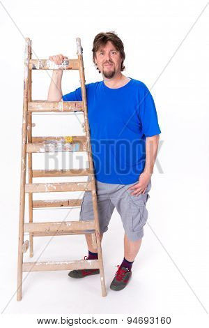 Smiling Man Standing Next To A Ladder