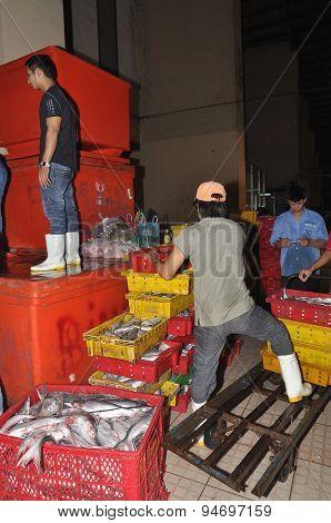Ho Chi Minh City, Vietnam - November 28, 2013: Porters Are Working Hard To Load Plenty Baskets Of Fi