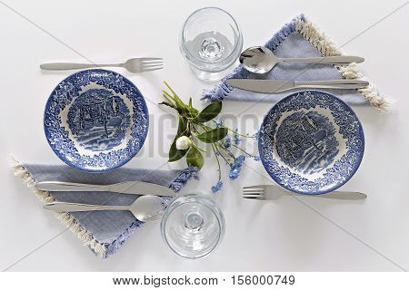 Empty plates and glasses romantic dinner for two. Homey atmosphere clean white table. Top view