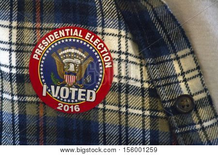 Close up of a 2016 North Carolina election sticker with a symbol of the American eagle and flag stating