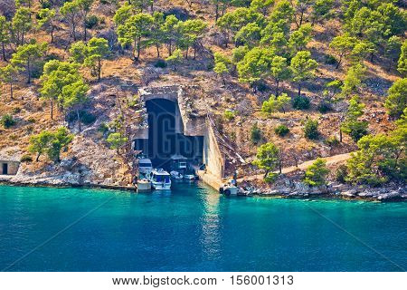 Boat and submarine shelter on Brac island stone coast Dalmatia Croatia