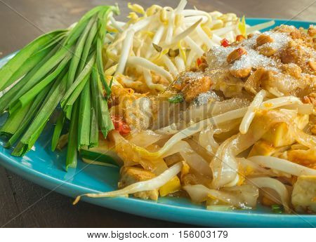 Closeup Pad Thai with blue dish on wooden table Thai food