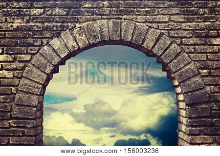 Background sky looking through an old brick window.