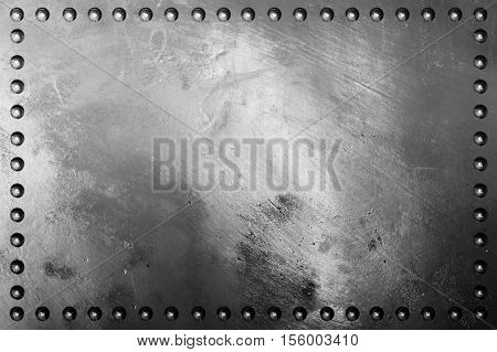Dark metal plate texture with rivet for background