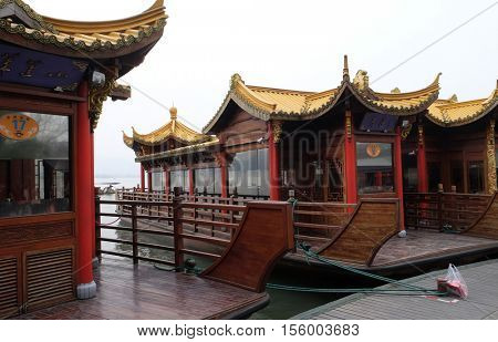 HANGZHOU - FEBRUARY 21: Traditional boat restaurant at the West Lake (Xi hu lake), freshwater lake in Hangzhou. UNESCO World Heritage Site, Hangzhou, China, February 21, 2016.