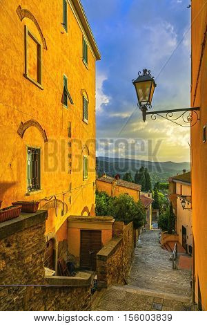 Castagneto Carducci old stone village in Maremma on sunset. Picturesque flowery street and traditional houses. Tuscany Italy Europe.