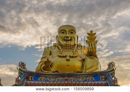 Golden Sangkat Ja Buddha with Twilight sky background.