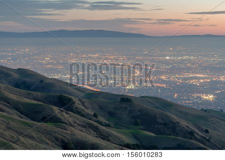 Silicon Valley and Rolling Hills at Dusk. Mission Peak Regional Preserve, Fremont, California, USA. West views of San Francisco South Bay and Santa Cruz Mountains with classic California rolling hills.