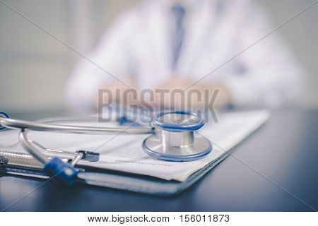 Medicine doctor's working table. Focus on stethoscope vintage tone. Doctor man. Doctor woman. Tool doctor. Doctor room.