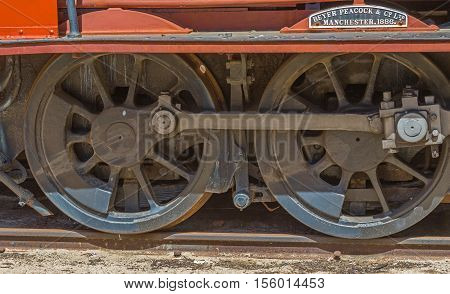 PERTH AUSTRALIA - OCTOBER 16 2016: Detail of the wheels of a red steam locomotive built by Beyer Peacock & Co, of Manchester, in 1886. The locomotive is on display at the Bassendean Railway Museum in Perth, Western Australia.