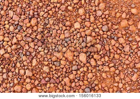 abstract background with red stones on the ground