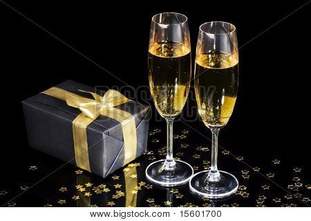 Elegant gift box and two champagne flutes for  celebration special event
