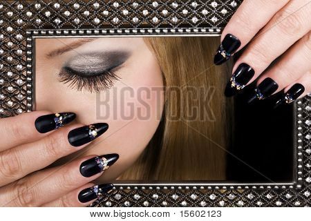 Picture of beauty. Closeup of woman beautiful face and hands.
