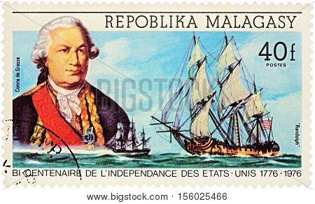 MOSCOW RUSSIA - NOVEMBER 08 2016: A stamp printed in Malagasy shows French admiral comte de Grasse and ship