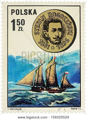 MOSCOW RUSSIA - NOVEMBER 11 2016: A stamp printed in Poland shows sailship and medal with bas-relief of Stefan Rogozinski - Polish explorer of Africa series